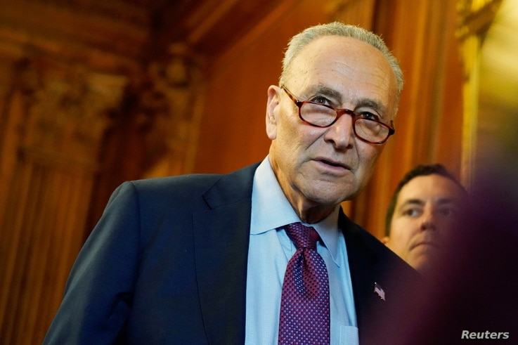 FILE PHOTO: U.S. Senate Majority Leader Chuck Schumer attends a news conference with mothers helped by Child Tax Credit…