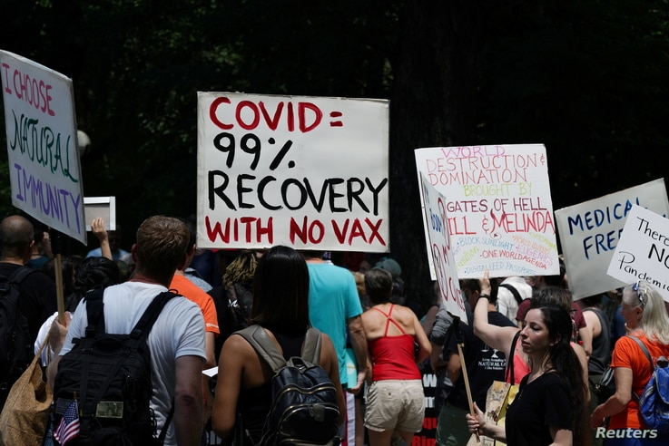 People gather during an anti-vaccine demonstration, amid the coronavirus disease (COVID-19) pandemic, in Central Park, New York…
