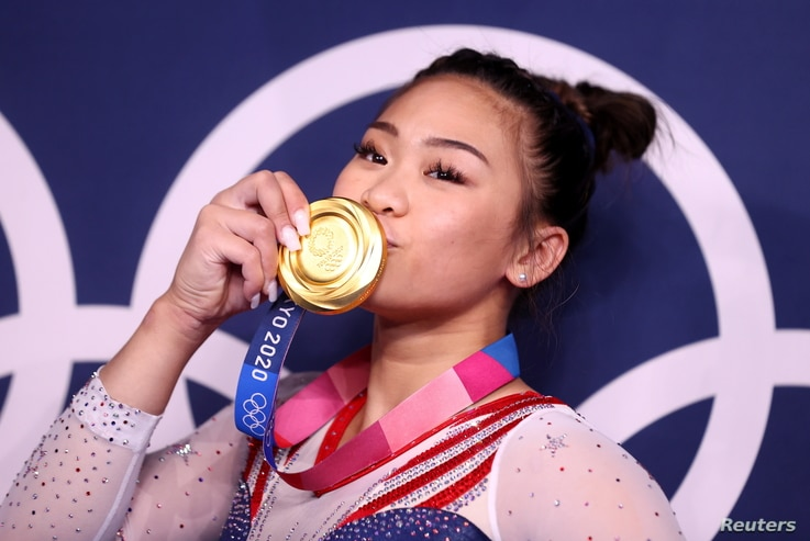 Gold medallist Sunisa Lee of the United States kisses her medal in front of the olympic rings, Ariake Gymnastics Centre, Tokyo, Japan - July 29, 2021.