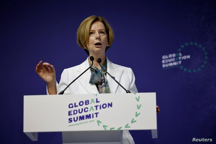 Australia's former prime minister Julia Gillard gestures as she speaks during the closing ceremony on the second day of the…