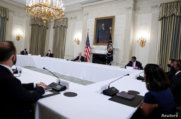 U.S. President Joe Biden meets with Cuban American leaders in the State Dining Room at the White House in Washington, U.S.,...