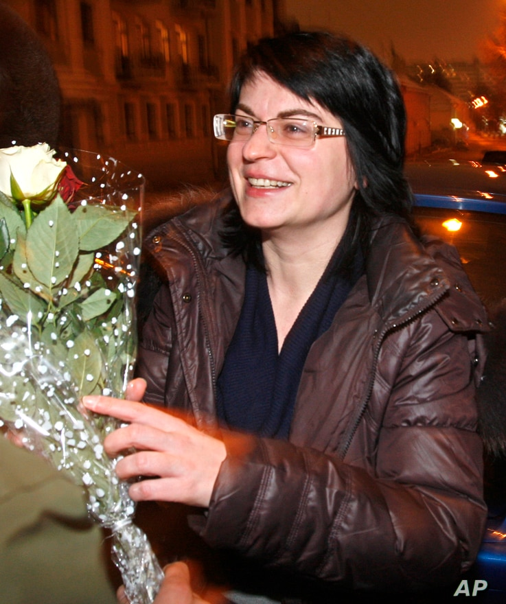 Natalya Radina, editor-in-chief of the Charter97 website, gets flowers from her friends as she was released from prison in the…