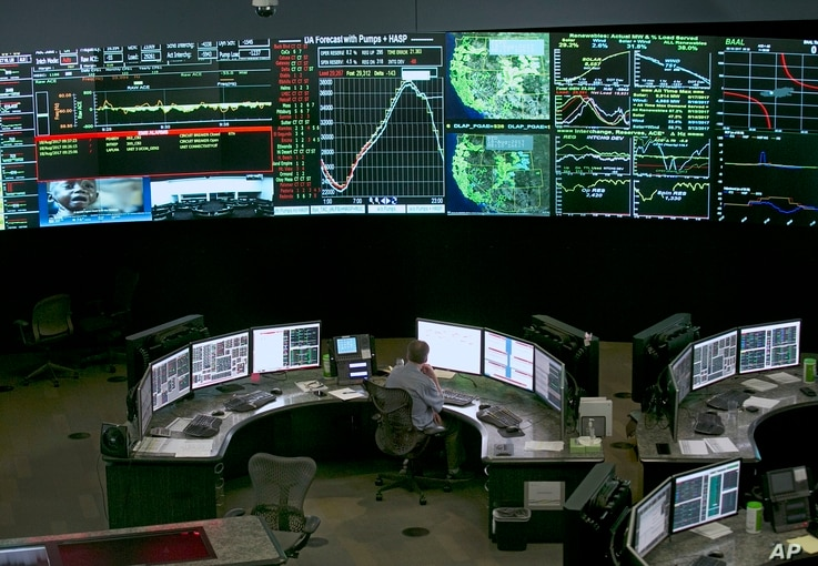 FILE - In this Aug. 18, 2017, file photo, electrical power flow and conditions are monitored at the California Independent...