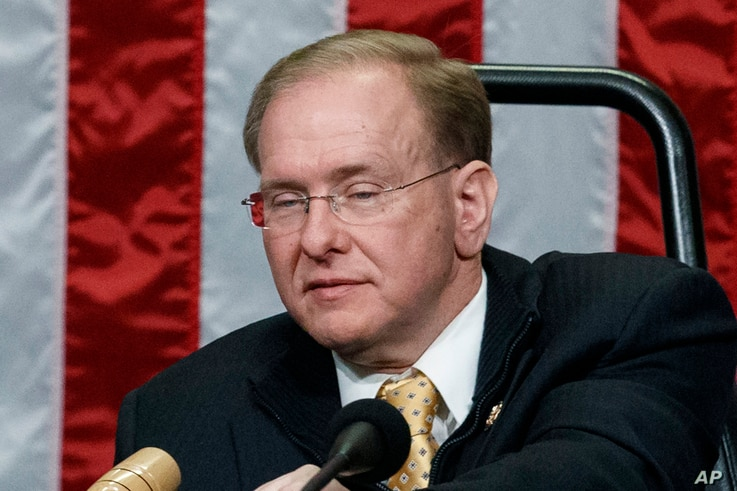 FILE - In this Jan. 3, 2019, file photo, Rep. Jim Langevin, D-R.I., prepares the dais after he was chosen as Speaker pro…