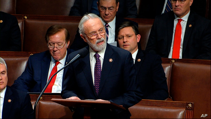 FILE - In this Dec. 18, 2019 file photo Rep. Dan Newhouse, R-Wash., speaks as the House of Representatives debates the articles...