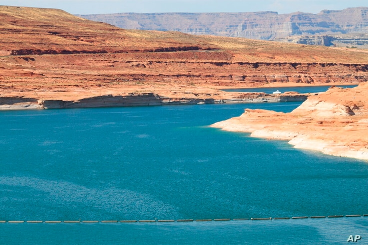 This Aug. 21, 2019 image shows Lake Powell near Page, Arizona. A plan by Utah could open the door to the state pursuing an…