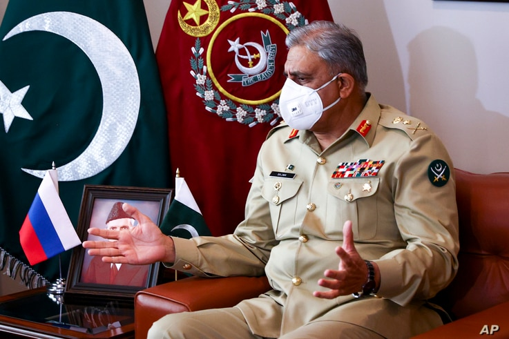 In this handout photo released by Russian Foreign Ministry Press Service, Pakistan's Army Chief Gen. Qamar Javed Bajwa gestures…