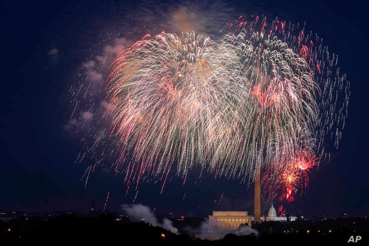 FILE - In this Saturday, July 4, 2020, file photo, Fourth of July fireworks explode over the Lincoln Memorial, the Washington…