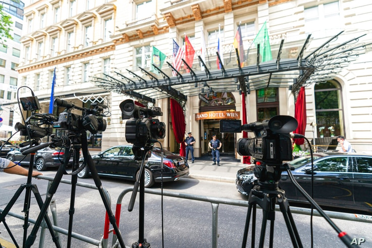 TV cameras in front of the 'Grand Hotel Vienna' where closed-door nuclear talks take place in Vienna, Austria, Sunday, June 20,...