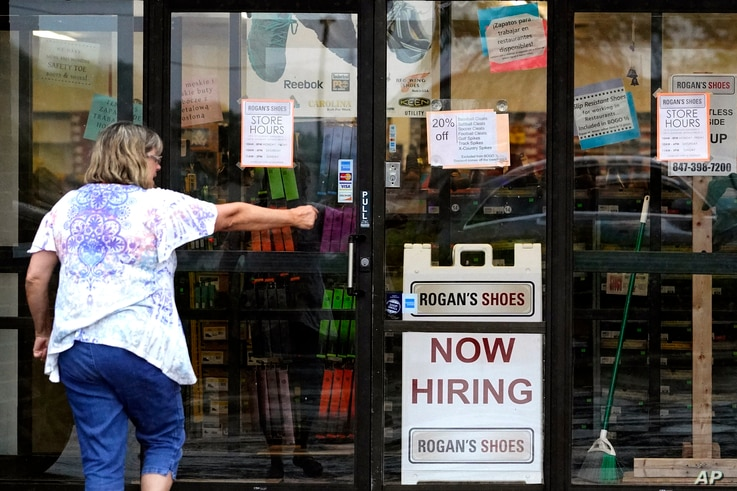 **HOLD FOR BIZ**A hiring sign shows at a retail store in Buffalo Grove, Ill., Thursday, June 24, 2021. All 14 metropolitan...