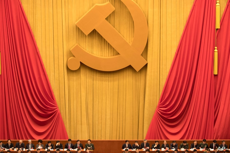 In this Oct. 18, 2017, file photo, Chinese communists party cadres attend the opening ceremony of the 19th Party Congress held…