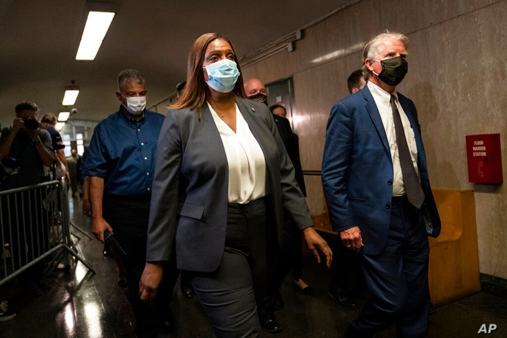 Letitia James, attorney general of New York, center, and Cyrus Vance Jr., New York County District Attorney, right, leave…