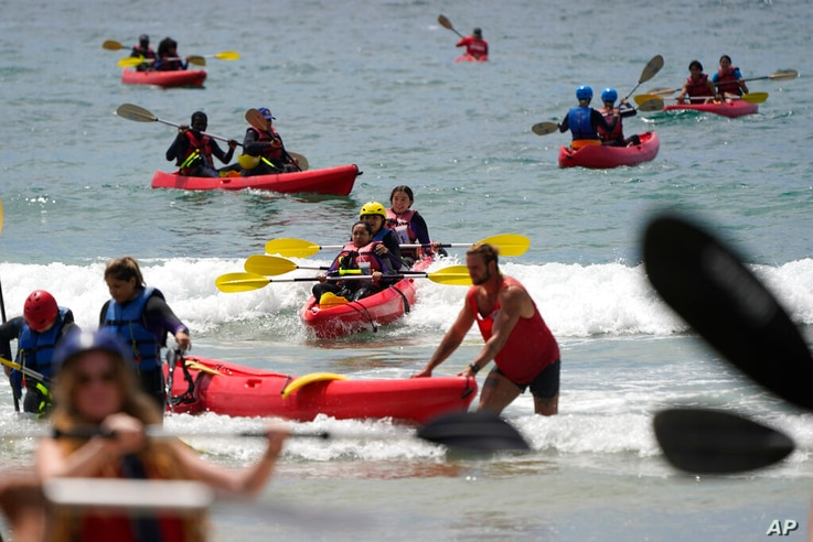 People take kayak lessons at La Jolla Shores beach as Independence Day weekend nears, Thursday, July 1, 2021, in San Diego…