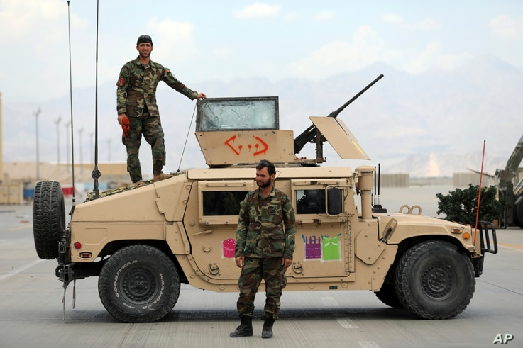 Afghan army soldiers stand guard after the American military left Bagram air base, in Parwan province north of Kabul.