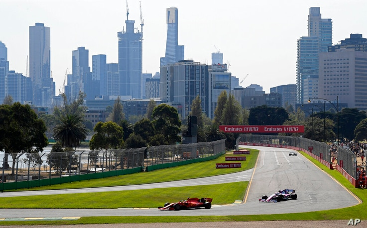 FILE - In this March 16, 2019, file photo, Formula One cars race on the circuit during the final practice session for the…