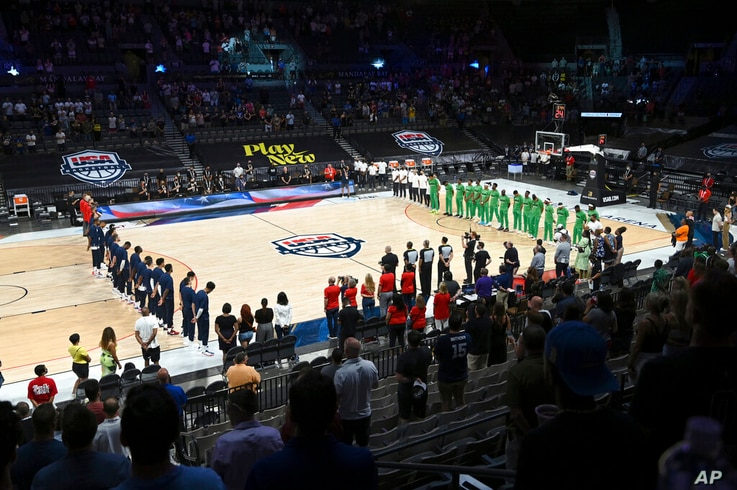 United States and Nigeria stand for the national anthem before their exhibition basketball game Saturday, July 10, 2021, in Las…
