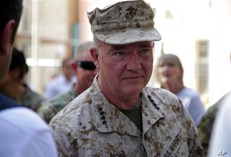 Marine Gen. Frank McKenzie, the head of U.S. Central Command, attends at a ceremony where Gen. Scott Miller, who has served as…