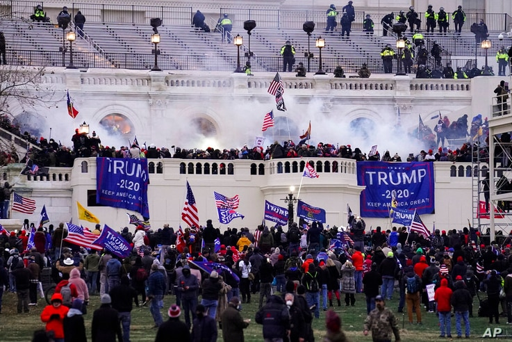 FILE - In this Jan. 6, 2021, file photo, violent protesters, loyal to then-President Donald Trump, storm the Capitol, Wednesday...