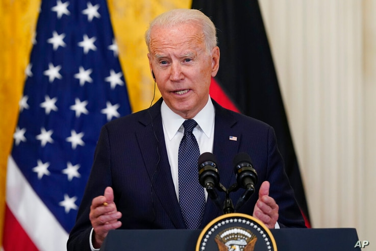 President Joe Biden speaks during a news conference with German Chancellor Angela Merkel in the East Room of the White House in…