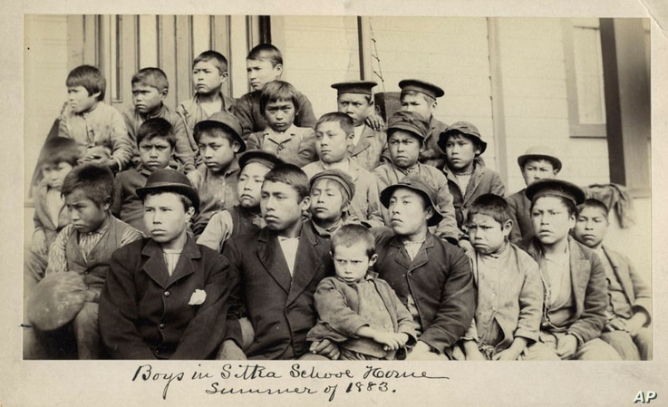 This photo made available by the Presbyterian Historical Society, Philadelphia shows students at a Presbyterian boarding school...