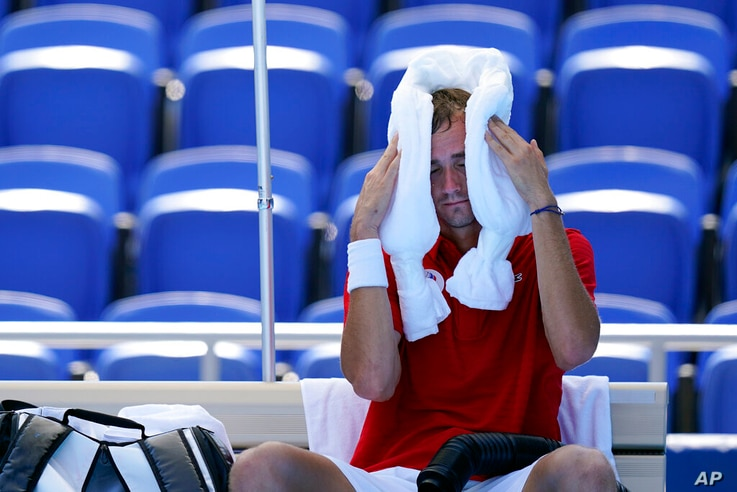 Daniil Medvedev, of the Russian Olympic Committee, cools off during a changeover in a tennis match against Alexander Bublik, of...