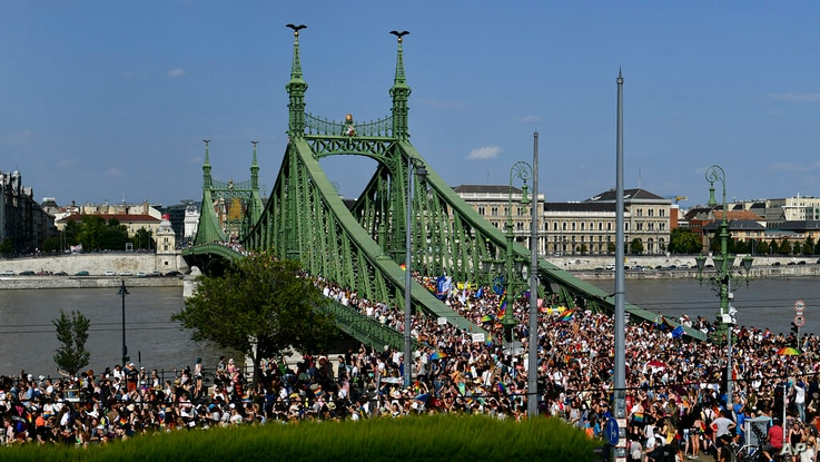People march across the Szabadsag, or Freedom Bridge over the River Danube in downtown Budapest during a gay pride parade in...