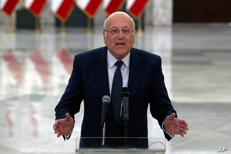 Lebanese Prime Minister-designate Najib Mikati, speaks to journalists after his meeting with Lebanese President Michel Aoun, at the Presidential Palace in Baabda, east of Beirut, Lebanon, July 26, 2021.