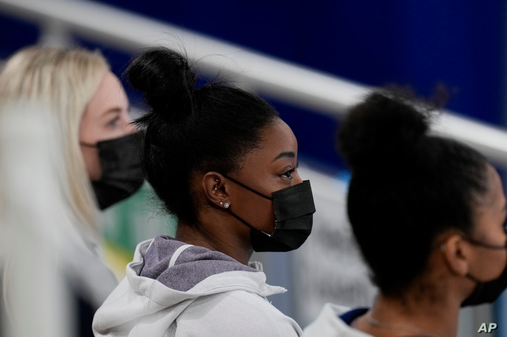 United States gymnast Simone Biles sits on the stands during the artistic gymnastics women's all-around final at the 2020 Summer Olympics, July 29, 2021, in Tokyo, Japan.