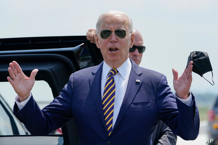 President Joe Biden responds to reporters' questions about infrastructure as he arrives at Lehigh Valley International Airport in Allentown, Pennsylvania, July 28, 2021.