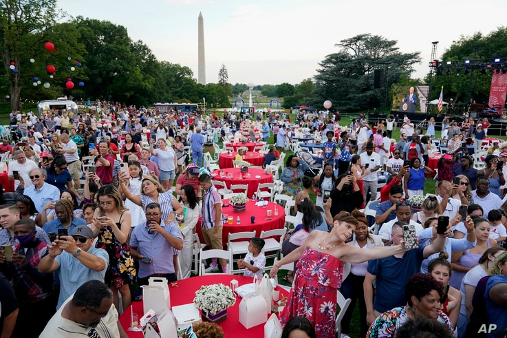 Attendees listen as President Joe Biden speaks during an Independence Day celebration on the South Lawn of the White House, in Washington, July 4, 2021.