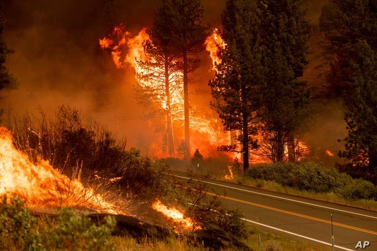 The Tamarack Fire burns in the Markleeville community of Alpine County, California, July 17, 2021.