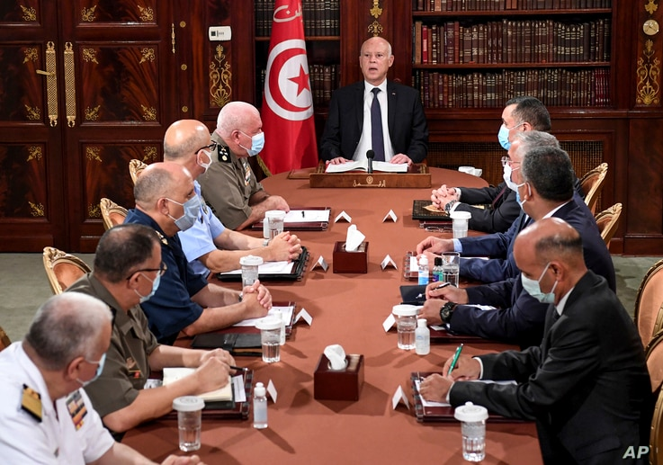 Tunisia's President Kais Saied, center, leads a security meeting with members of the army and police forces in Tunis, July 25, 2021.