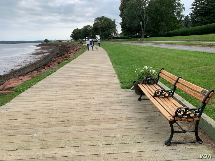 Locals enjoy the view along the Charlottetown waterfront. (Jay Heisler/VOA)