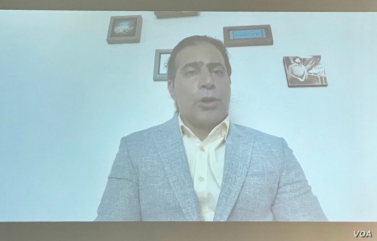 In this image from a video message on June 29, 2021, former Iranian political prisoner Mohammad Nikbakht addresses a human rights conference hosted by Washington's National Press Club on June 30, 2021. (Michael Lipin/VOA)