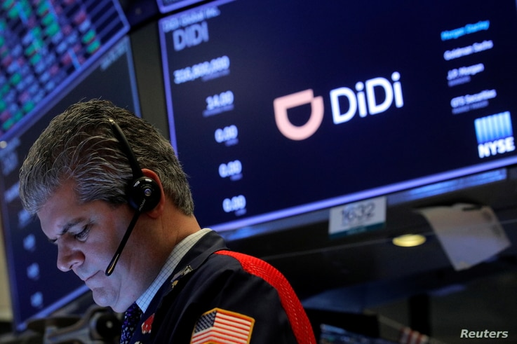 FILE - A trader works during the IPO for Chinese ride-hailing company Didi Global Inc on the New York Stock Exchange floor in New York City, June 30, 2021.