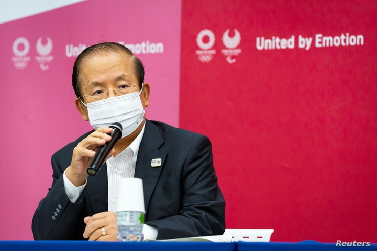 FILE - Tokyo 2020 Olympics chief Toshiro Muto speaks during the news conference in Tokyo, Japan, June 18, 2021.