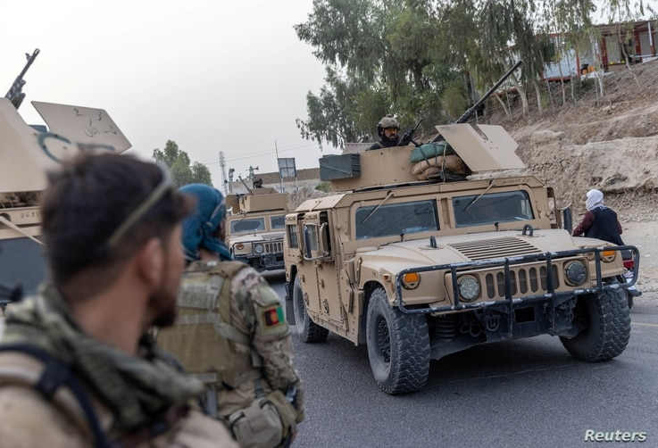 A convoy of Afghan Special Forces is seen during the rescue mission of a police officer besieged at a check post surrounded by Taliban, in Kandahar province, July 13, 2021.