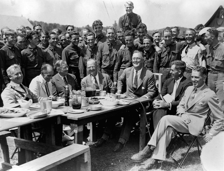President Franklin D. Roosevelt having lunch at mess table in Camp Fechner, a Civilian Conservation Corps camp, at Big Meadows, Va.