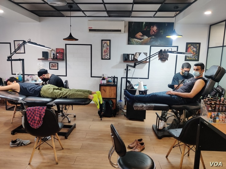 Tattoos of all kinds have gained popularity among a section of young and more affluent people who see the body art as an expression of their personality. (Anjana Pasricha/VOA)