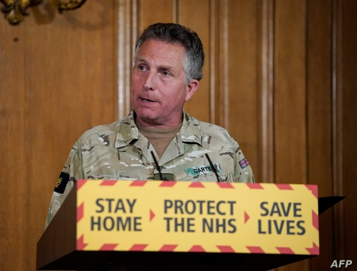 A handout image released by 10 Downing Street, shows Britain's Chief of Defence Staff General Nick Carter attending a remote...