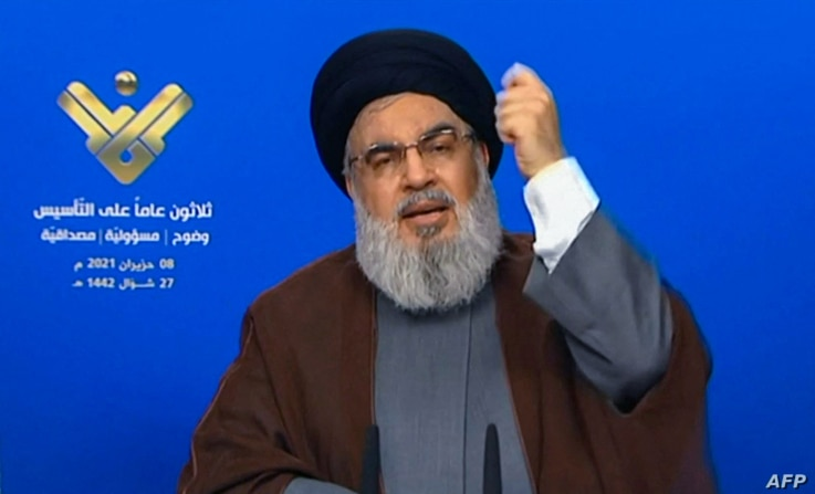 An image grab taken from Hezbollah's al-Manar TV on June 8, 2021, shows the leader of the Lebanese Shiite party Hassan…