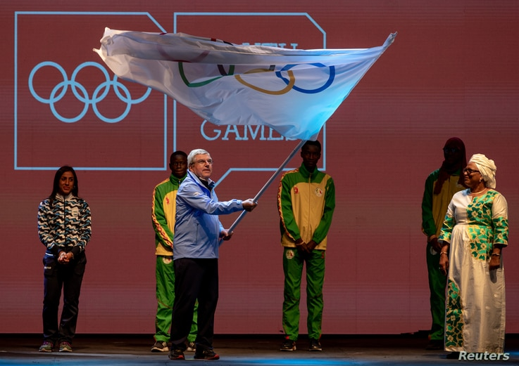 President of the International Olympic Committee Thomas Bach waves the Olympic Flag in the Handover Ceremony during the Closing…