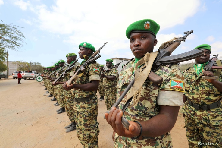 Burundian African Union Mission in Somalia (AMISOM) peacekeepers stand in formation during a ceremony as they prepare to leave…