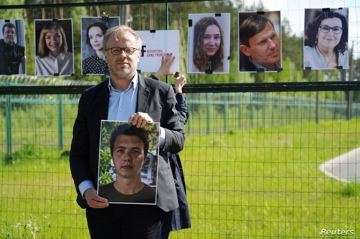 Reporters Sans Frontiers Secretary General Christophe Deloire holds a picture of detained Belarus blogger Roman Protasevich at…