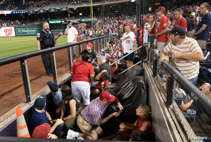 Jul 17, 2021; Washington, District of Columbia, USA; Fans take cover after apparent gun shots were heard during the game…