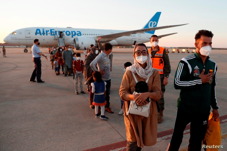 Nilofar Bayat, captain of the Afghan wheelchair basketball team, arrives next to her compatriots who were evacuated from Kabul…