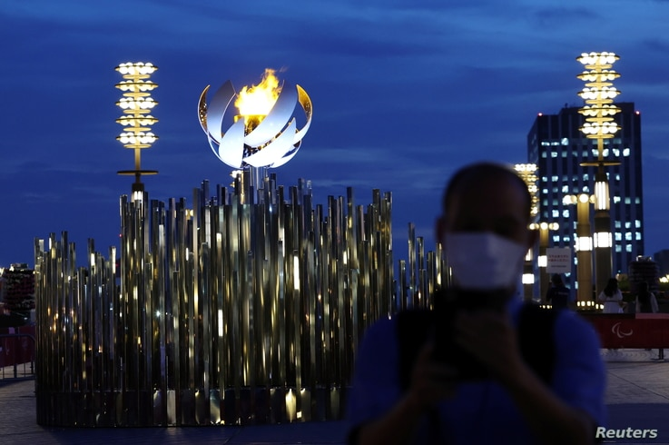 A man wearing a protective mask, amid the coronavirus disease (COVID-19) pandemic, stands in front of the second Paralympic…
