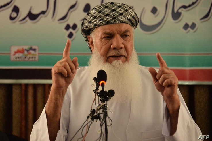 FILE - Afghan warlord and former Mujahideen leader Mohammed Ismail Khan addresses a gathering at his home in Herat, Afghanistan, July 9, 2021.