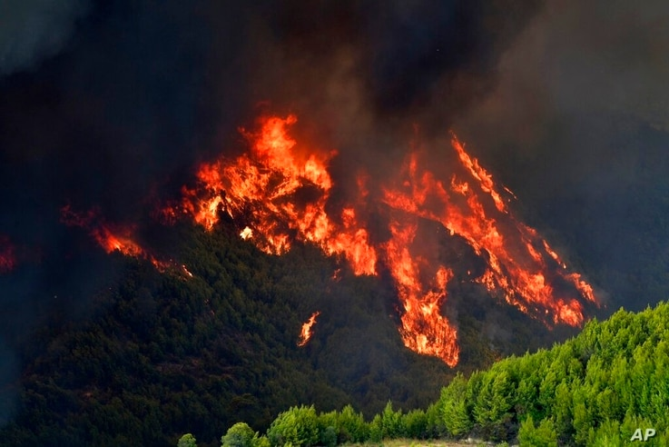 Flames burn a mountain in Platanos village, near ancient Olympia, western Greece, Wednesday, Aug. 4, 2021. The European Union…
