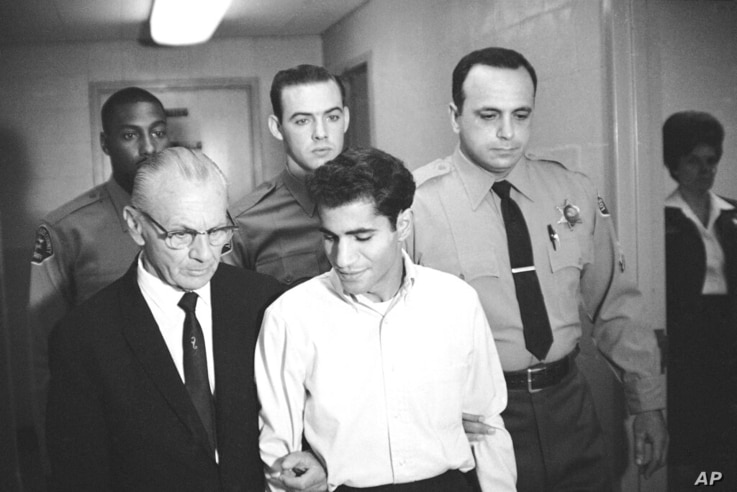 FILE - In this June 28, 1968, file photo, Sirhan Bishara Sirhan is escorted by his attorney, Russell E. Parsons from Los…
